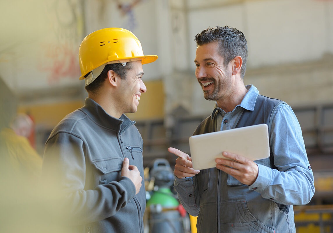 workers talking and laughing at a factory